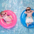 Baby Twin Boy and Girl Floating on Swim Rings