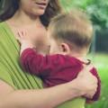 Mother breastfeeding baby in park