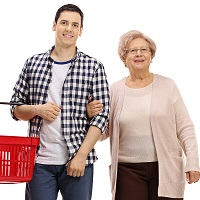 Young man with a shopping basket and an elderly woman