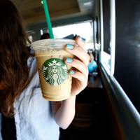 FILE PHOTO: A patron holds an iced beverage at a Starbucks coffee store in Pasadena